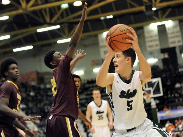 Shen's Thomas Huerter, right, looks to pass as Mount Vernon's Demetre Roberts defends during their Class AA State boys basketball semifinal on Saturday, March 21, 2015, at Glens Falls Civic Center in Glens Falls, N.Y. (Cindy Schultz / Times Union) Photo: Cindy Schultz / 10031109A