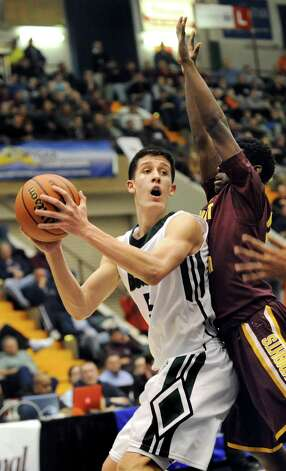 Shen's Thomas Huerter, left, looks to pass as Mount Vernon's Demetre Roberts defends during their Class AA State boys basketball semifinal on Saturday, March 21, 2015, at Glens Falls Civic Center in Glens Falls, N.Y. (Cindy Schultz / Times Union) Photo: Cindy Schultz / 10031109A