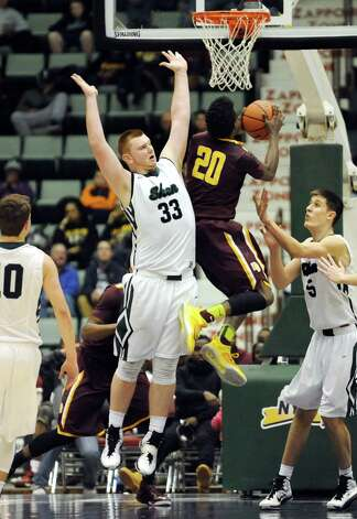 Shen's Matt Alverson, left, tries to block a shot from Mount Vernon's Marco Morecy during their Class AA State boys basketball semifinal on Saturday, March 21, 2015, at Glens Falls Civic Center in Glens Falls, N.Y. (Cindy Schultz / Times Union) Photo: Cindy Schultz / 10031109A