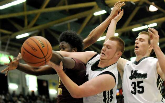 Shen's Matt Alverson, center, and Brandon Fischer go against Mount Vernon's Derrick Hamlin for a rebound during their Class AA State boys basketball semifinal on Saturday, March 21, 2015, at Glens Falls Civic Center in Glens Falls, N.Y. (Cindy Schultz / Times Union) Photo: Cindy Schultz / 10031109A