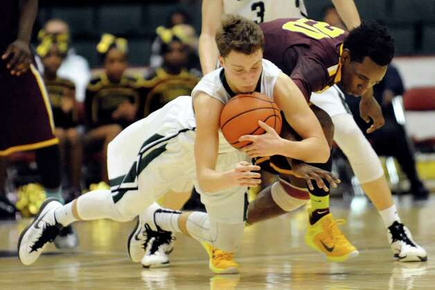 Shen's Drew Lewis, left, recovers a loose ball against Mount Vernon's Marco Morency during their Class AA State boys basketball semifinal on Saturday, March 21, 2015, at Glens Falls Civic Center in Glens Falls, N.Y. (Cindy Schultz / Times Union) Photo: Cindy Schultz / 10031109A