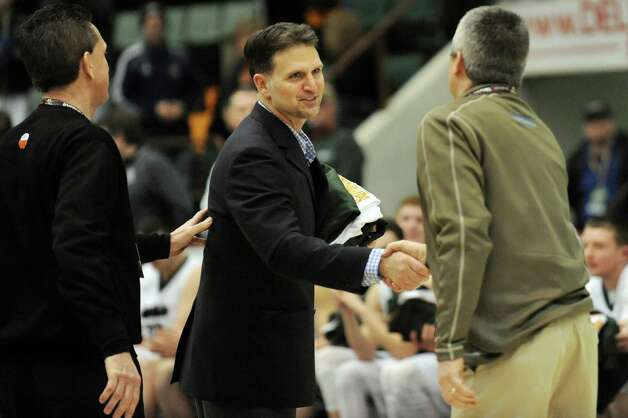 Shen's coach Tony Dzikas, center, is recognized when his team wins 60-52 over Mount Vernon in the Class AA State boys basketball semifinal on Saturday, March 21, 2015, at Glens Falls Civic Center in Glens Falls, N.Y. (Cindy Schultz / Times Union) Photo: Cindy Schultz / 10031109A