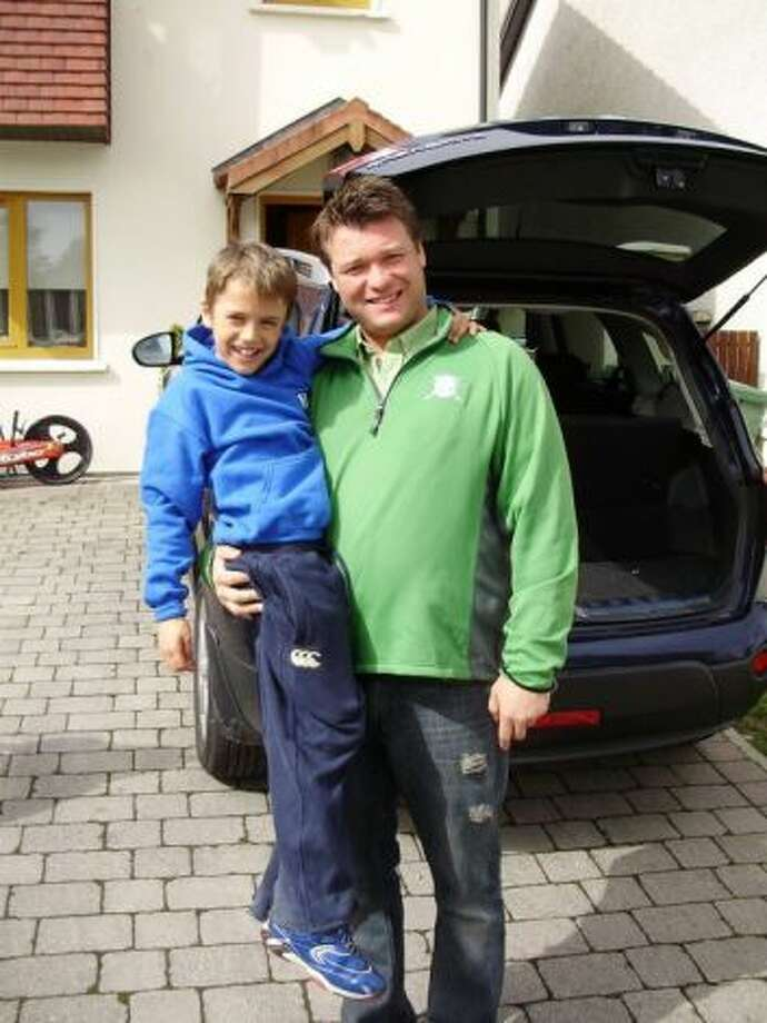 Daniel Satre, who died in a September confrontation with police, with his son during a visit to Ireland. (Photo provided by Satre's family.)