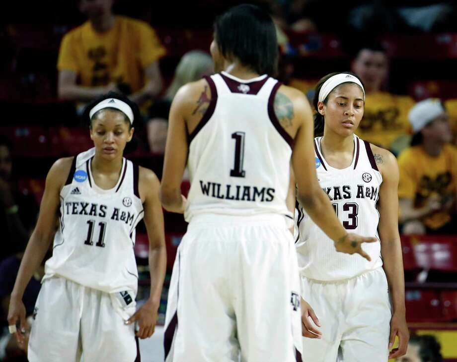 Texas A&M guard Chelsea Jennings (13) reacts to a foul call against her as teammate Courtney Williams (1) walks to her during the second half of a women's first round NCAA tournament college basketball game against Arkansas Little Rock, Saturday, March 21, 2015, Tempe, Ariz. Arkansas Little Rock won 69-60. At left is Curtyce Knox (11). (AP Photo/Matt York) Photo: Matt York, STF / Associated Press / AP