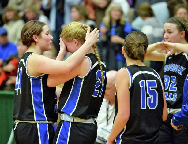 Hoosick Falls's #44 Chelsea Stevens, left, consoles team mate #21 Anna Wysocki after their loss to Susquehanna Valley in the state Class B basketball final at Hudson Valley Community College Saturday March 21, 2015 in Troy, NY.  (John Carl D'Annibale / Times Union) Photo: John Carl D'Annibale / 10031110A