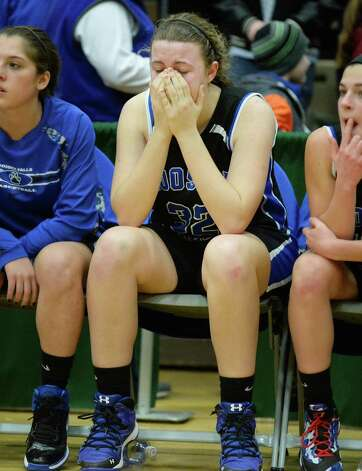 Hoosick Falls's #32 Megan Flynn, center, after their loss to Susquehanna Valley in the state Class B basketball final at Hudson Valley Community College Saturday March 21, 2015 in Troy, NY.  (John Carl D'Annibale / Times Union) Photo: John Carl D'Annibale / 10031110A