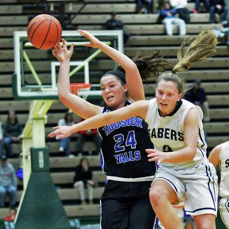 Hoosick Falls's #24 Kelly Pine, left, and Susquehanna Valley's #4 Courtney Knapp chase the ball during the state Class B basketball final at Hudson Valley Community College Saturday March 21, 2015 in Troy, NY.  (John Carl D'Annibale / Times Union) Photo: John Carl D'Annibale / 10031110A