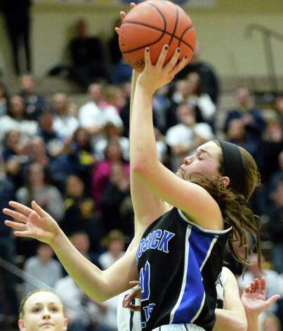 Hoosick Falls's #10 Rachel Pine is fouled as she goes to the basket during the state Class B basketball final against Susquehanna Valley at Hudson Valley Community College Saturday March 21, 2015 in Troy, NY.  (John Carl D'Annibale / Times Union) Photo: John Carl D'Annibale / 10031110A