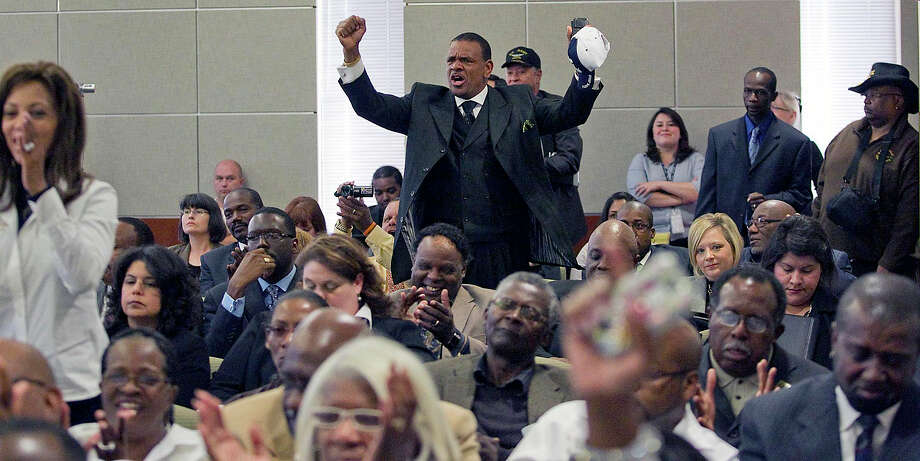 A crowd cheers in 2011 after the Department of Motor Vehicles board decided Texas drivers won't be able to put Confederate license plates on their vehicles. Photo: Austin American-Statesman / Austin American-Statesman