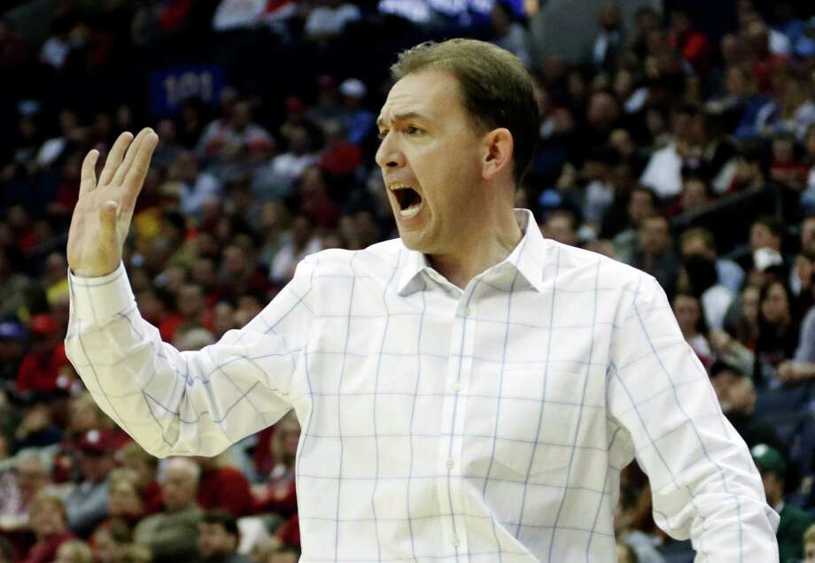 Albany head coach Will Brown yells at his team in the second half of an NCAA tournament college basketball game against Oklahoma in the Round of 64 in Columbus, Ohio, Friday, March 20, 2015. (AP Photo/Paul Vernon) ORG XMIT: OHMD167 Photo: Paul Vernon / FR66830 AP