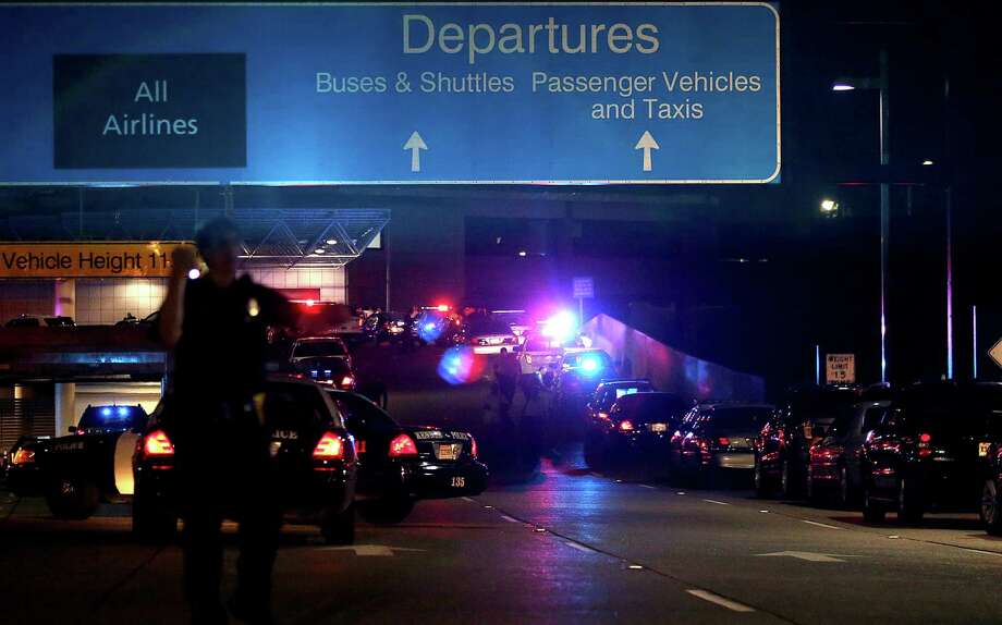 Emergency vehicles swarmed the Louis Armstrong New Orleans International Airport on Friday after a man sprayed people with wasp killer and pulled out a machete. rom his waistband and began chasing a TSA agentThe ramp to departures is seen blocked off by emergency vehicles at the New Orleans International Airport, Friday, March 20, 2015, in Kenner, La. Richard White sprayed a TSA agent in the face with wasp killer then slashed a second guard with a machete before a third agent shot him three times at a security checkpoint in the New Orleans international airport Friday. (AP Photos/Jonathan Bachman) Photo: Jonathan Bachman /Associated Press / FR170615 AP