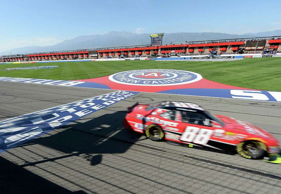 FONTANA, CA - MARCH 21:  Kevin Harvick, driver of the #88 taxslayer.com Chevrolet, crosses the finish line to win the NASCAR XFINITY Series Drive4Clots.com 300 at Auto Club Speedway on March 21, 2015 in Fontana, California.  (Photo by Harry How/Getty Images) ORG XMIT: 543844151 Photo: Harry How / 2015 Getty Images