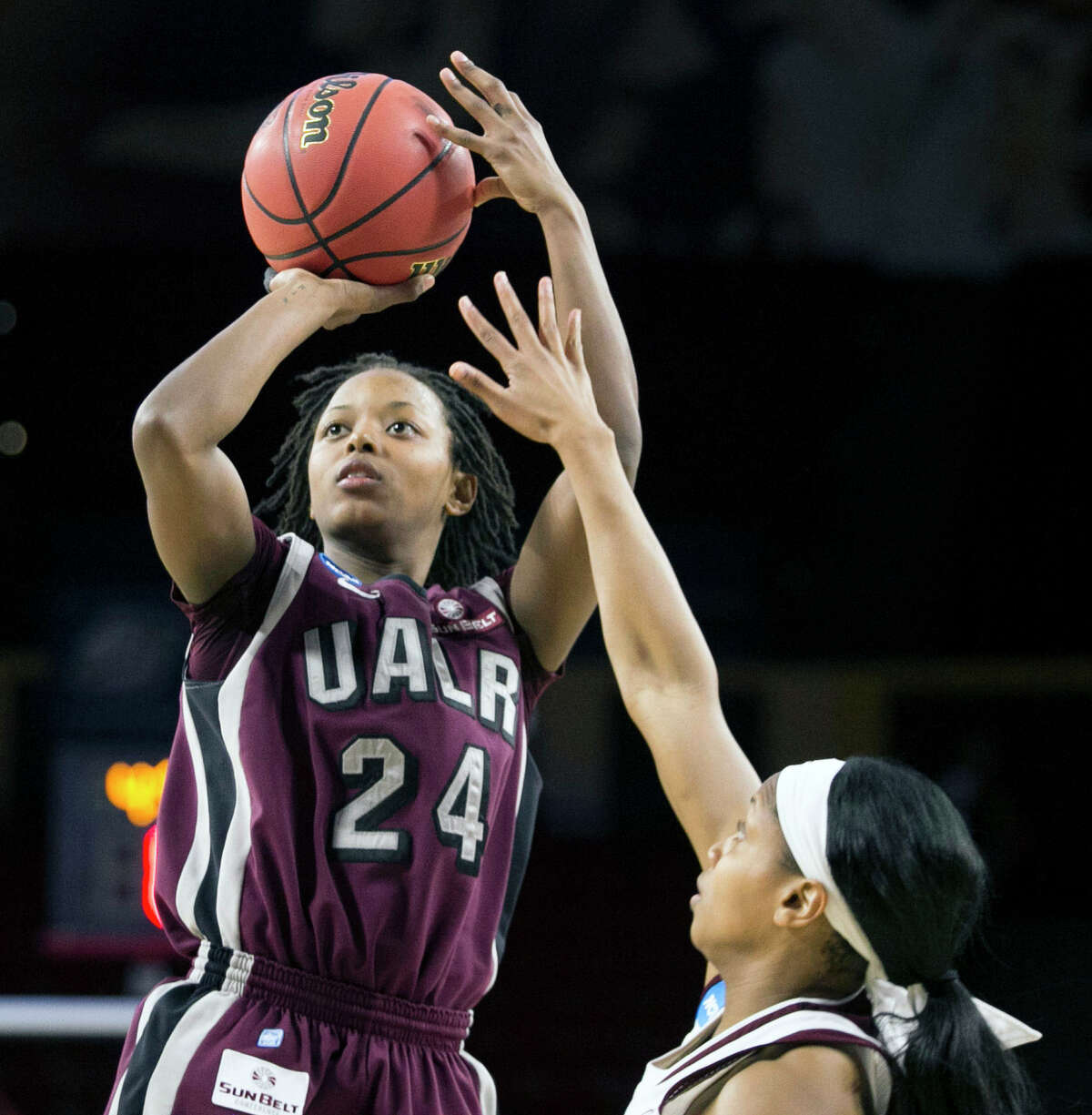 Arkansas-Little Rock guard Taylor Gault (24) was too much to handle for Texas A&M's Chelsea Jennings and her teammates, scoring a season-high 25 points.
