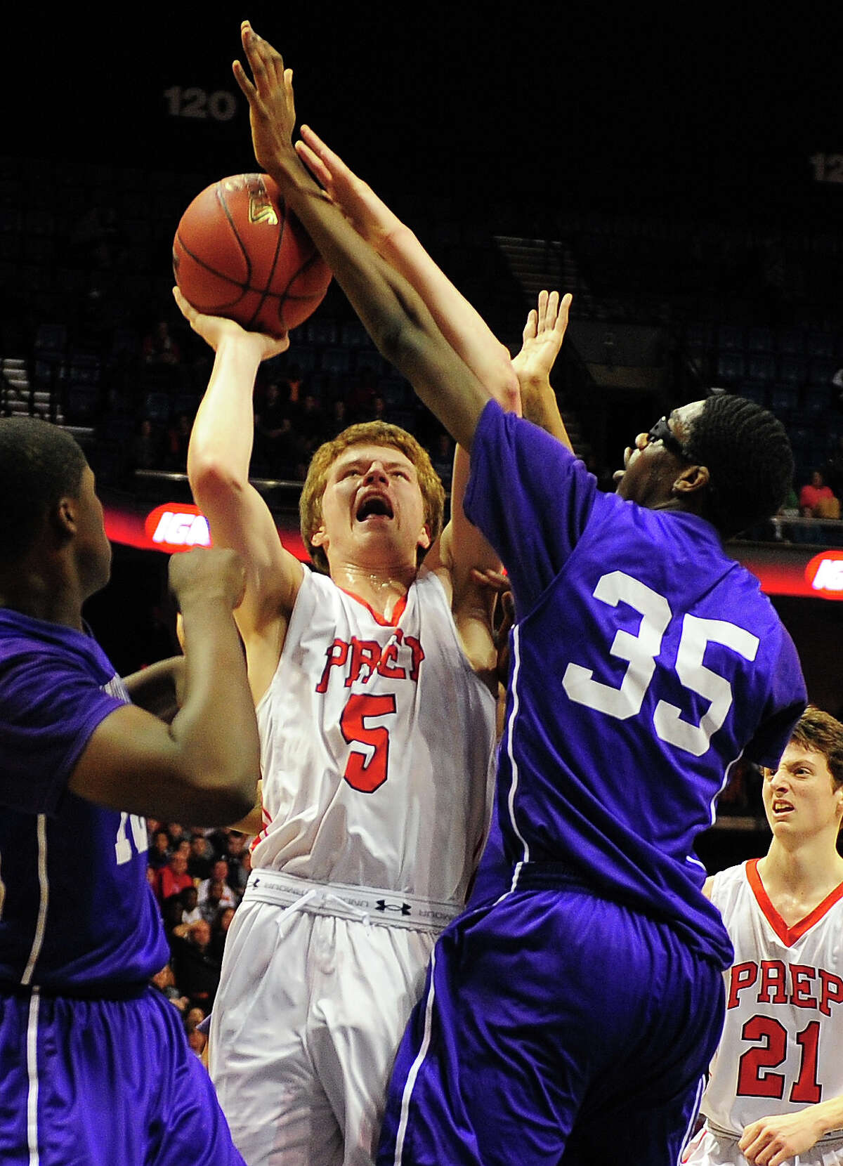 Westhill'sBrendon Thomas, right, blocks Fairfield Prep's Thomas Nolan as he attempts a shot, during CIAC State Boys Basketball Tournament action at Mohegan Sun in Uncasville, Conn., on Saturday Mar. 21, 2015.