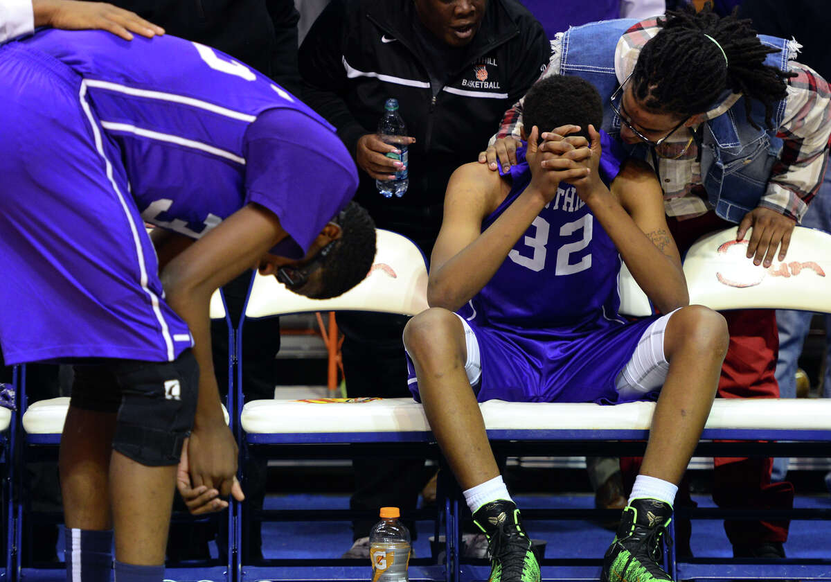Westhill team members react after losing to Fairfield Prep, during CIAC State Boys Basketball Tournament action at Mohegan Sun in Uncasville, Conn., on Saturday Mar. 21, 2015.