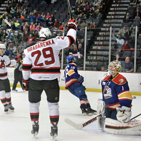 Albany Devils's #29 Raman Hrabarenka celebrates his goal against Norfolk Admirals goalie #1 Jason LaBarbera, right, during Saturday's game at the Times Union Center  March 21, 2015 in Albany, NY.  (John Carl D'Annibale / Times Union) Photo: John Carl D'Annibale / 00030124O