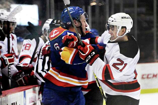 Norfolk Admirals #6 Nathan McIver, left, and Albany Devils's #21 Graham Black tangle during Saturday's game at the Times Union Center  March 21, 2015 in Albany, NY.  (John Carl D'Annibale / Times Union) Photo: John Carl D'Annibale / 00030124O