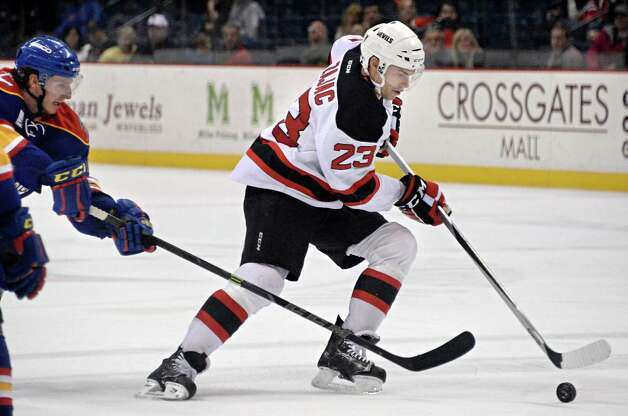 Albany Devils's #23 Darcy Zajac, right, gets past Norfolk Admirals defenders during Saturday's game at the Times Union Center  March 21, 2015 in Albany, NY.  (John Carl D'Annibale / Times Union) Photo: John Carl D'Annibale / 00030124O