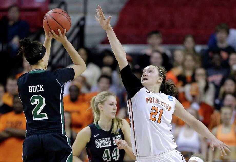 Princeton forward Alex Wheatley, right, tries to block a shot attempt by Green Bay guard Tesha Buck in the first half of an NCAA college basketball game in the first round of the NCAA tournament, Saturday, March 21, 2015, in College Park, Md. (AP Photo/Patrick Semansky) ORG XMIT: MDPS105 Photo: Patrick Semansky / AP