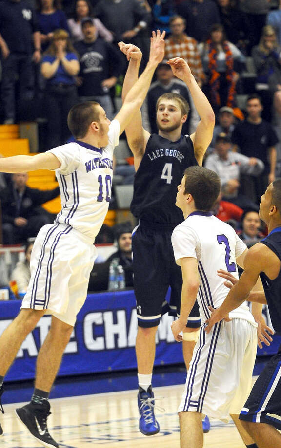 Joel Wincowski hits the winning 3-pointer for Lake George in its Class C state final against Waterville at Glens Falls Civic Center on Saturday, March 21, 2015. (Steve Jacobs / Glens Falls Post-Star)
