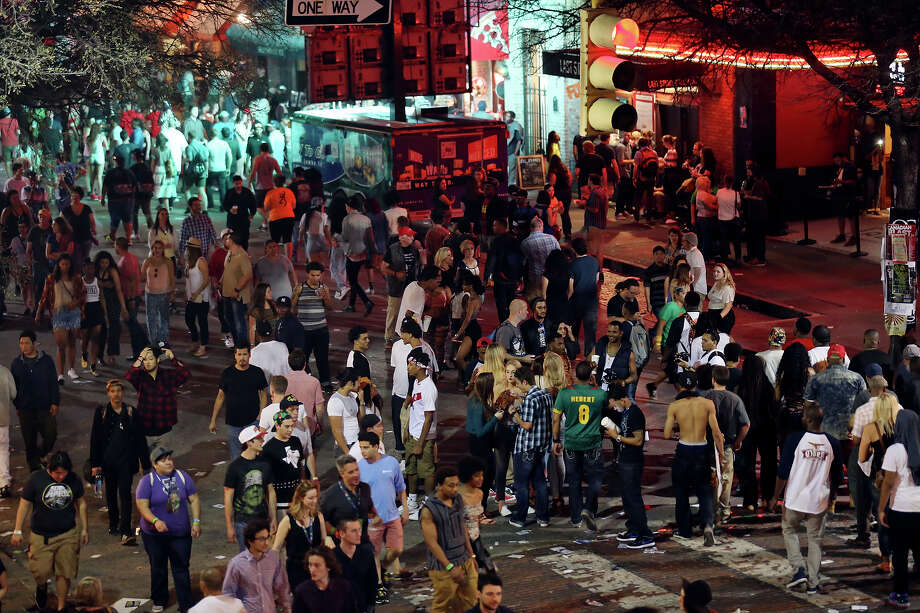 Crowds meander on 6th Street during South by Southwest Thursday March 19, 2015 in Austin, TX. Photo: Edward A. Ornelas, Staff / San Antonio Express-News / © 2015 San Antonio Express-News