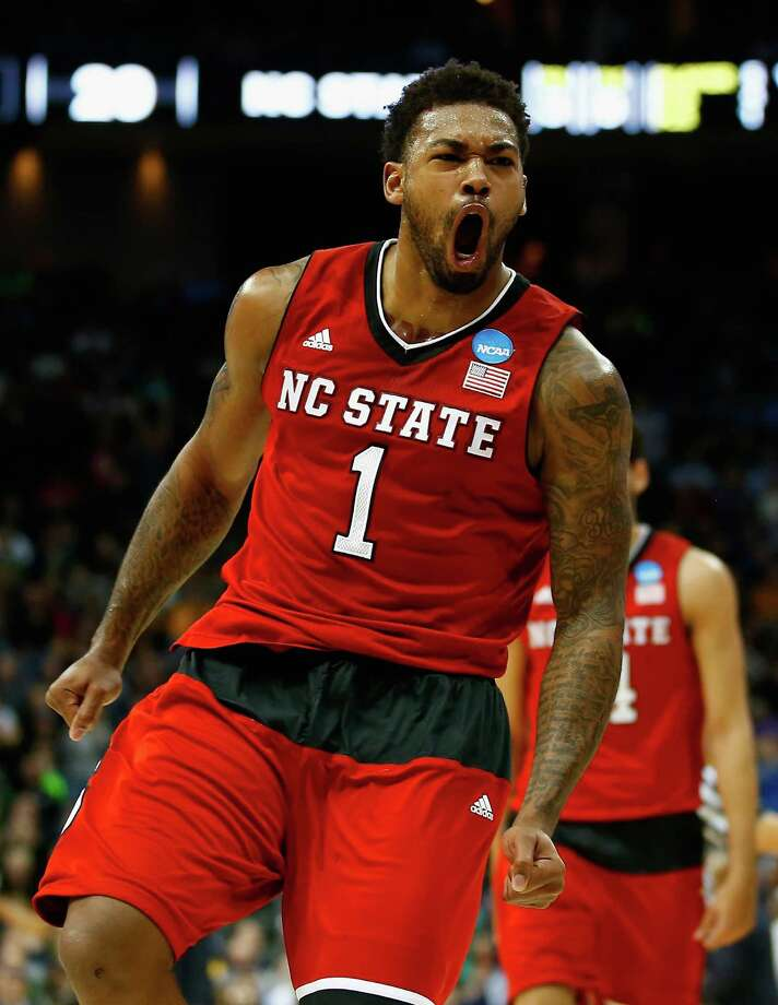 PITTSBURGH, PA - MARCH 21:  Trevor Lacey #1 of the North Carolina State Wolfpack celebrates after hitting a three pointer at the end of the first half against the Villanova Wildcats during the third round of the 2015 NCAA Men's Basketball Tournament at Consol Energy Center on March 21, 2015 in Pittsburgh, Pennsylvania.  (Photo by Jared Wickerham/Getty Images) ORG XMIT: 527065637 Photo: Jared Wickerham / 2015 Getty Images