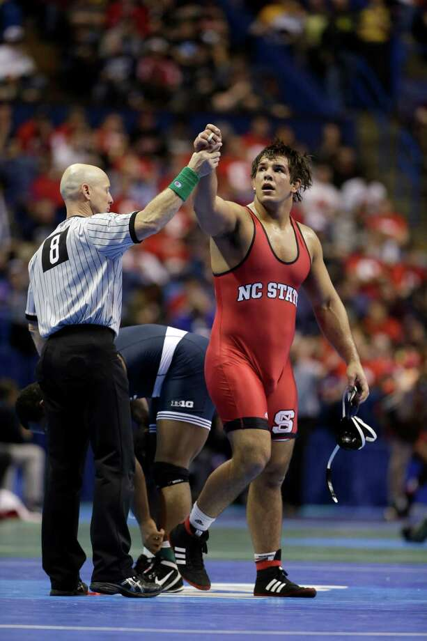 North Carolina State's Nick Gwiazdowski is declared the winner over Penn State's James Lawson during their 285-pound quarterfinal match Friday, March 20, 2015, at the NCAA Division I Wrestling Championships in St. Louis. (AP Photo/Jeff Roberson) ORG XMIT: MOJR128 Photo: Jeff Roberson / AP