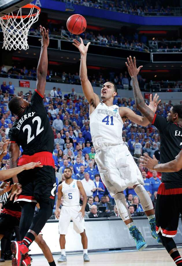 LOUISVILLE, KY - MARCH 21:  Trey Lyles #41 of the Kentucky Wildcats shoots over Coreontae DeBerry #22 of the Cincinnati Bearcats during the third round of the 2015 NCAA Men's Basketball Tournament at KFC YUM! Center on March 21, 2015 in Louisville, Kentucky.  (Photo by Joe Robbins/Getty Images) ORG XMIT: 527065613 Photo: Joe Robbins / 2015 Getty Images