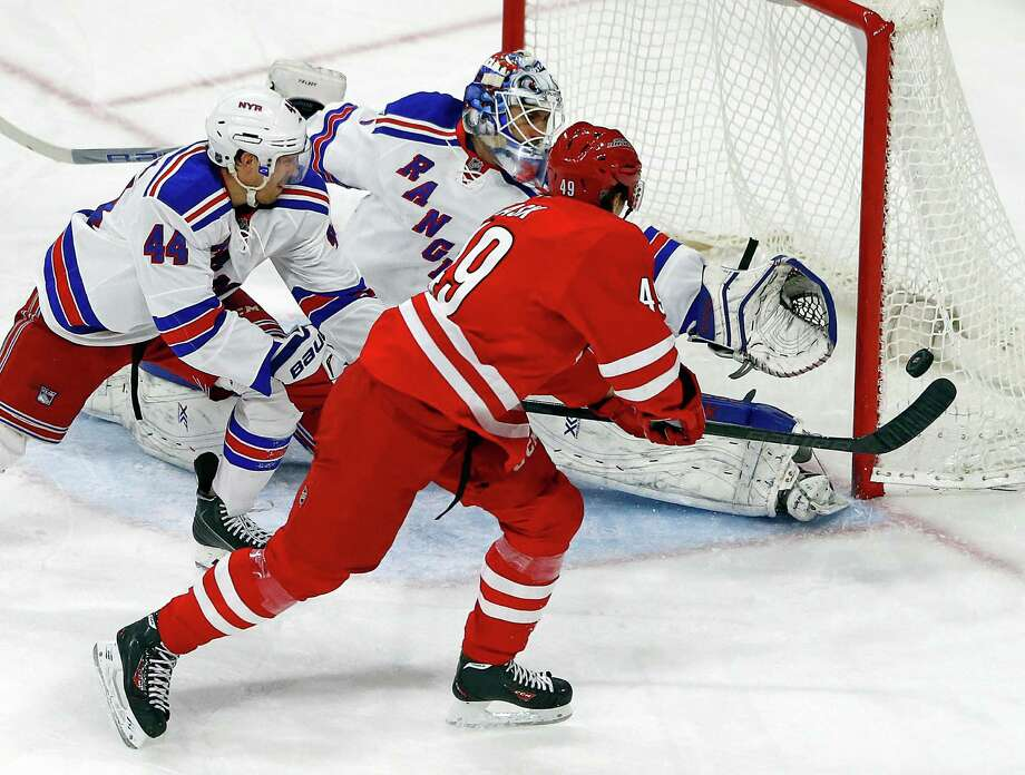 Carolina Hurricanes' Victor Rask (49) has his shot tipped wide by New York Rangers' Matt Hunwick (44) in front of goalie Cam Talbot (33) during the third period of an NHL hockey game Saturday, March 21, 2015, in Raleigh, N.C. The Rangers won 3-2 in a shootout. (AP Photo/Karl B DeBlaker) ORG XMIT: NCKD110 Photo: Karl B DeBlaker / FR7226 AP