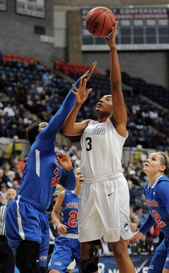 Connecticut's Morgan Tuck (3) shoots over St. Francis' Jaymee Veney, left, during the first half of a women's college basketball game in the first round of the NCAA tournament, Saturday, March 21, 2015, in Storrs, Conn. (AP Photo/Jessica Hill) ORG XMIT: CTJH112 Photo: Jessica Hill / FR125654 AP