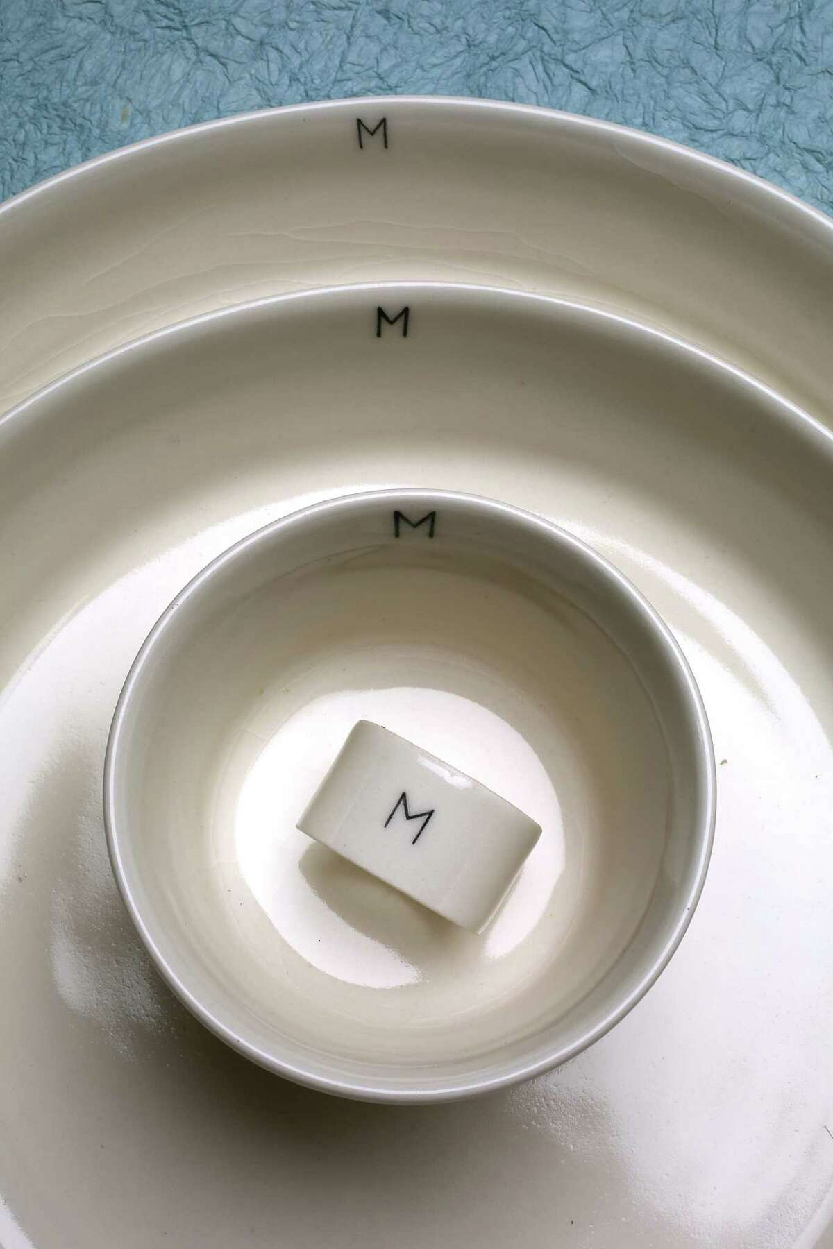 March's new porcelain dinnerware pieces are handmade and hand-painted, requiring a 15-week lead time.