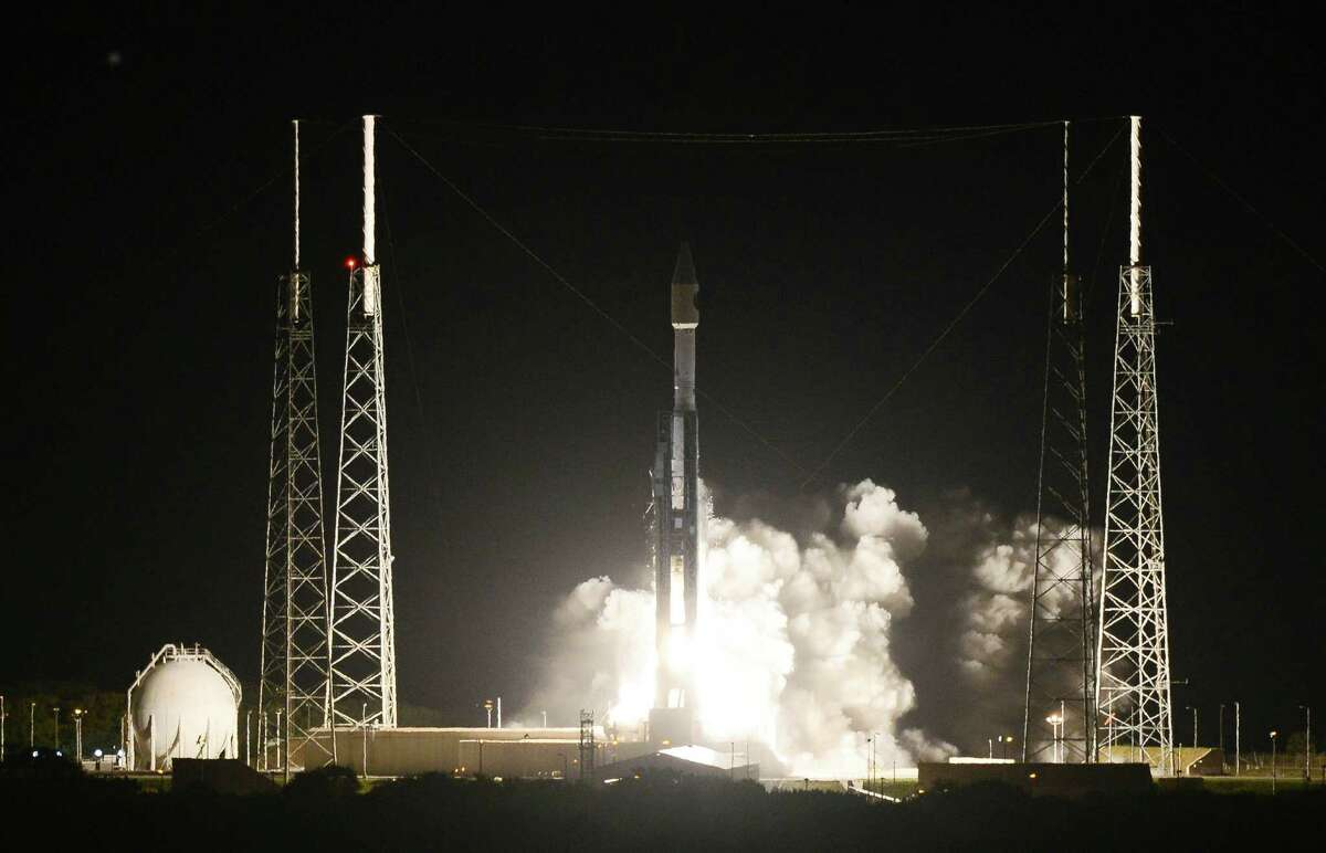 The unmanned Atlas rocket - and NASA's Magnetospheric Multiscale spacecraft lifts off from Cape Canaveral, Fla., Thursday, March 12, 2015. NASA launched four identical spacecraft Thursday on a billion-dollar mission to study the explosive give-and-take of the Earth and sun's magnetic fields. (AP Photo/Florida Today, Craig Bailey)