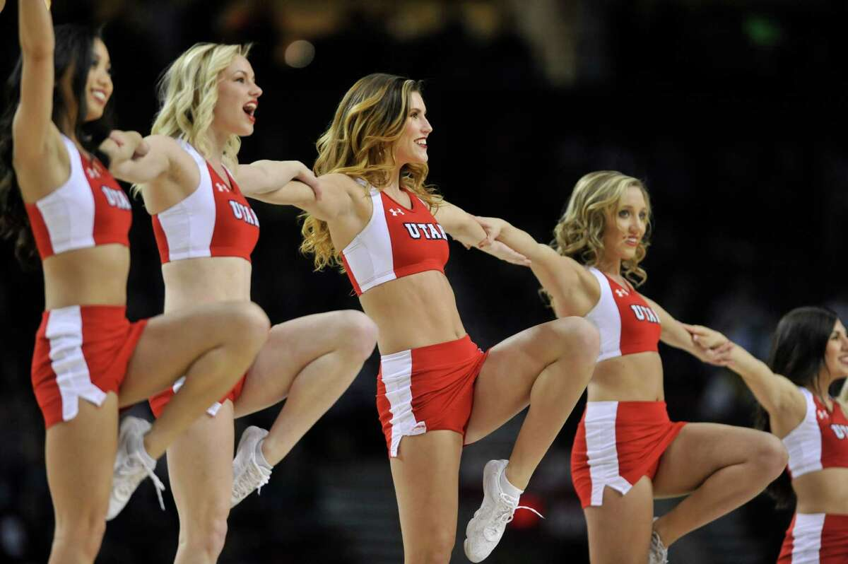 Utah cheerleaders are shown during the first half of an NCAA college basketball tournament round of 32 game in Portland, Ore., Saturday, March 21, 2015.