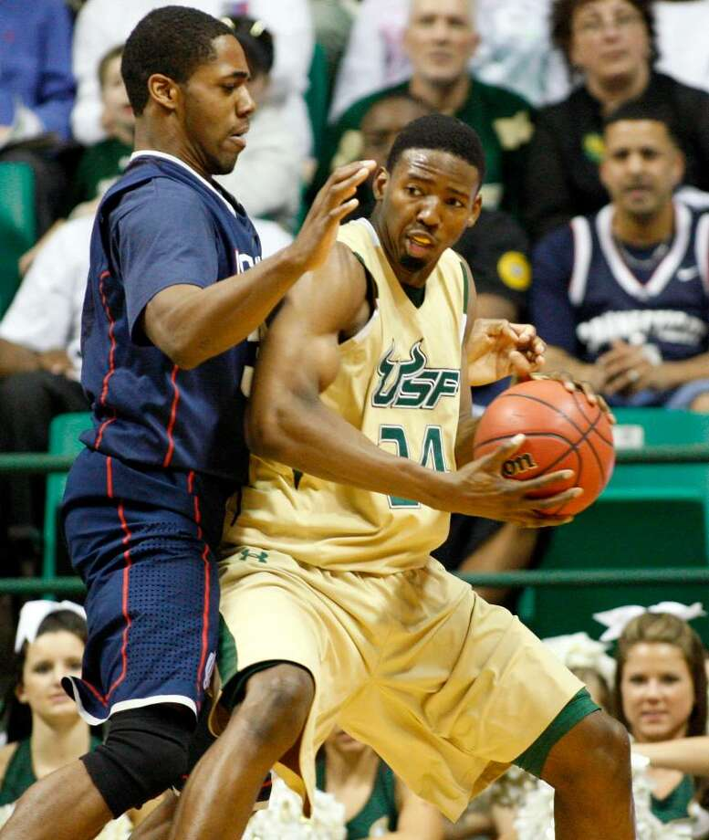 South Florida's Augustus Gilchrist, right, drives past Connecticut's Alex Oriakhi during the second half of an NCAA college basketball game Saturday, March 6, 2010, in Tampa, Fla. South Florida won 75-68. (AP Photo/Mike Carlson) Photo: Mike Carlson, ASSOCIATED PRESS / AP2010