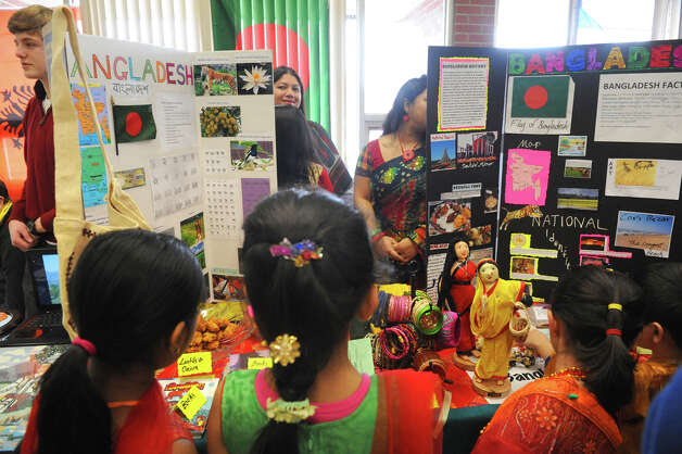 "Children gather around the Bangladesh booth during ""Shensational""  an annual celebration of cultural diversity at Shenendehowa High School west on Saturday March 21, 2015 in Clirton Park, N.Y. (Michael P. Farrell/Times Union) Photo: Michael P. Farrell / 10031095A"