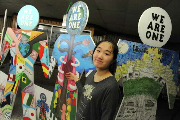 "Kyunglee Park a Kodda Middle School eighth grade student stands with a piece she created We Are One art program with artist Patrick Morelli during ""Shensational""  an annual celebration of cultural diversity at Shenendehowa High School west on Saturday March 21, 2015 in Clirton Park, N.Y. (Michael P. Farrell/Times Union) Photo: Michael P. Farrell / 10031095A"