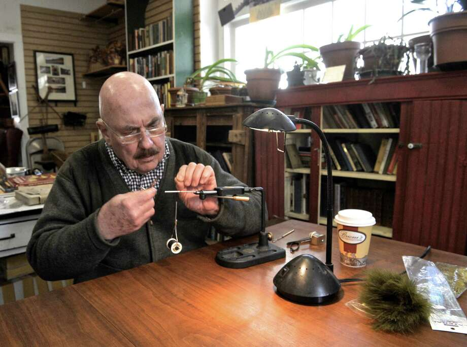 George Kenna was at Housatonic River Outfitters doing some fly tying on Thursday, March 19, 2015, in Cornwall Bridge, Conn. Kenna has been fly-fishing since the late 60's and tying his own flies since the mid 70's. Using a tying vise Kenna starts work on a new fly. Photo: H John Voorhees III / The News-Times