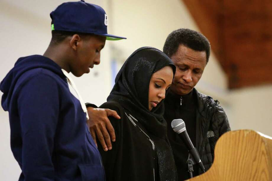 Flanked by her brother Madda and father Hussein, Urji Dadi spoke of her sister, Biftu Hussein Dadi at the New Holly Gathering Hall with on Friday, March 20, 2015. Dadi, 24, was killed March 9. Photo: JOSHUA TRUJILLO, SEATTLEPI.COM / SEATTLEPI.COM