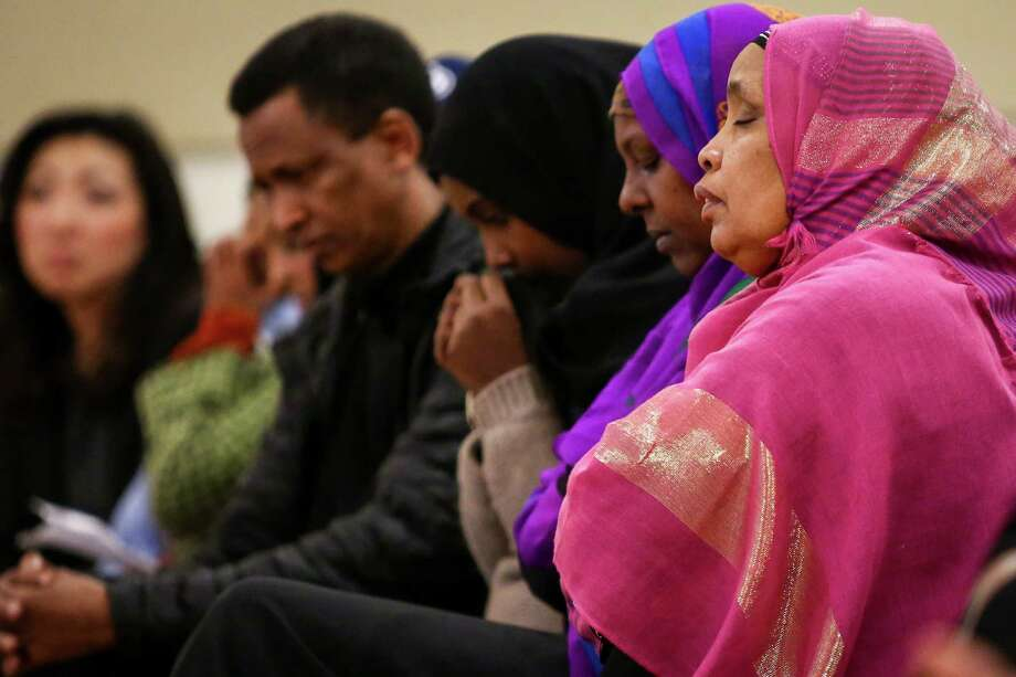 Family members of Biftu Hussein Dadi attend a memorial gathering for Biftu Hussein Dadi at the New Holly Gathering Hall with on Friday, March 20, 2015 in Seattle. Dadi, 24, was killed March 9. Photo: JOSHUA TRUJILLO, SEATTLEPI.COM / SEATTLEPI.COM