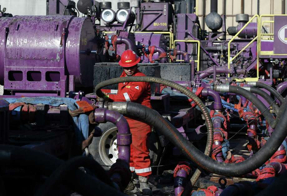 A worker adjusts hoses during a hydraulic fracturing operation at an Encana Corp. gas well, near Mead, Colo. Encana raised about $1 billion in January. Photo: Associated Press File Photo / AP