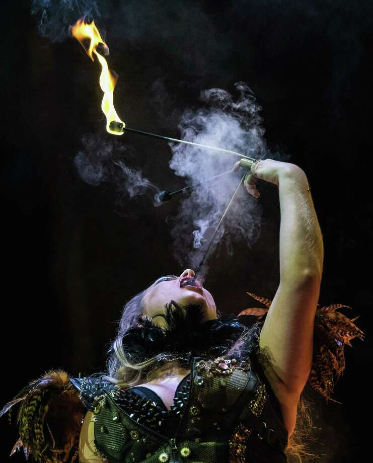 Asia Sawrka, a performer with the Circus of Horrors, performs during an evening show at the Town Hall on March 20, 2015 in Middlesbrough, England. The Circus of Horrors, billed as horror-themed circus freak show, debuted in 1995 at Glastonbury festival and in 2011 reached the finals of Britain's Got Talent. Last year they began a run in London's West End, the first circus to appear in a West End Theatre for 100 years. They are marking their 20th anniversary with their latest incarnation 'The night of the Zombies', which is set in a corpse ridden London in 2020 where the city is plagued by a swamp of zombies and ruled by the undead. Photo: Ian Forsyth, Getty Images / 2015 Getty Images