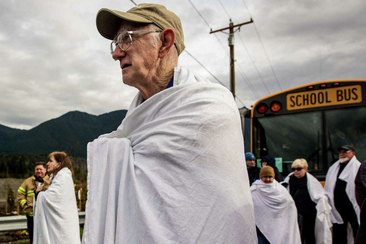 Friends and family members of slide victims arrive to a memorial event in honor of lost loved ones Sunday, March 22, 2015, on the one year anniversary of a landslide that left 43 dead in the town of Oso, Washington.