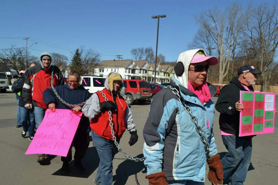 Lainey's Army, a group of animal rights activists, walked through Schenectady Sunday on their way to Albany, a 114-mile walk of awareness that started in Rome, Oneida County. The group carried a chain to raise awareness of animal cruelty. (Keshia Clukey/ Times Union)