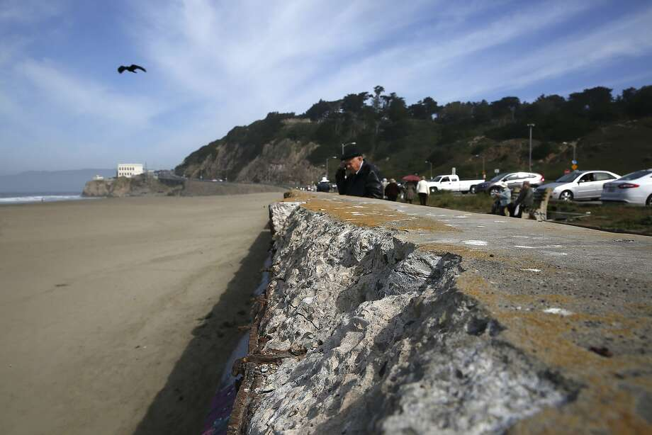 The 100-year-old O'Shaughnessy Seawall can be seen in this file photo taken at Ocean Beach in San Francisco on March 19, 2015. On Wednesday, four teenagers were pulled from the water off the beach after they were caught in a riptide. Photo: Liz Hafalia, The Chronicle