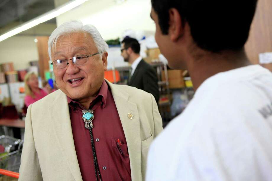 Rep. Mike Honda talks with constituents at the Sunnyvale Community Services building, where he helped hand out back-to-school backpacks in August. Photo: Michael Short / The Chronicle / ONLINE_YES