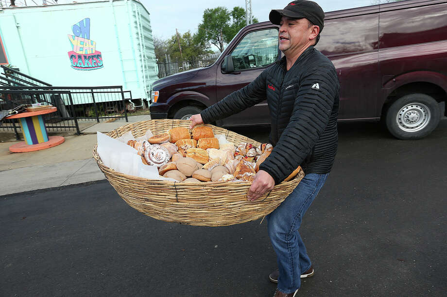 Jose Caceres, of La Panaderia, arrives with baskets full of bread at the Yard Farmers and Ranchers Market on Sunday, March 22, 105. Last week a controversy over racist remarks made by the market's owners led to at least six vendors leaving. Photo: JERRY LARA, Staff / San Antonio Express-News / © 2015 San Antonio Express-News