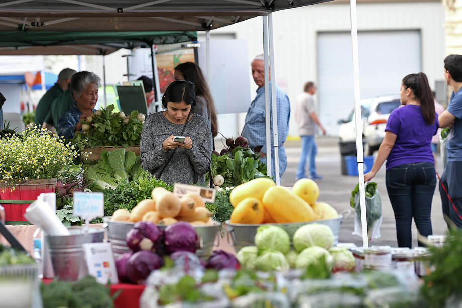 Marcela Cortez shops at the Yard Farmers and Ranchers Market on Sunday, March 22. Last week a controversy over racist remarks made by the market's owners led to at least six vendors leaving. Photo: Jerry Lara /San Antonio Express-News / © 2015 San Antonio Express-News