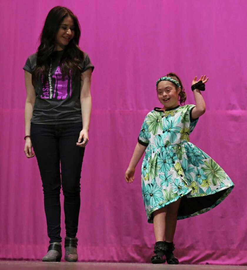 Mara Ortiz, 12, a fifth-grader at Oak Crest Intermediate School, shows off the outfit that Wagner High School junior Emily Felan, 18, designed for her during the eighth annual FashionAble show at O'Connor High School. Photo: Edward A. Ornelas /San Antonio Express-News / © 2015 San Antonio Express-News