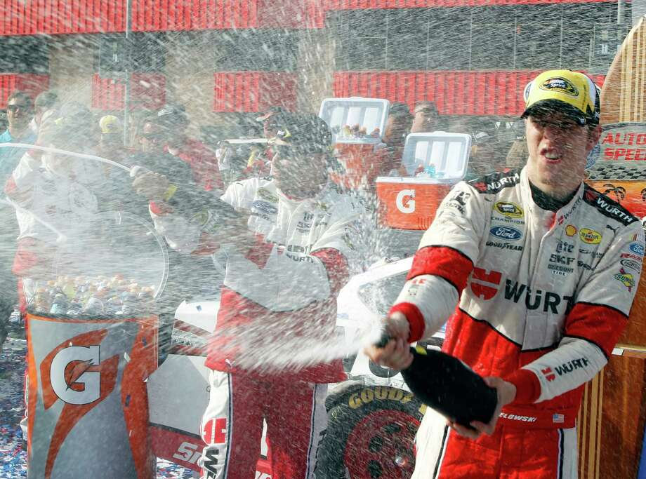 Brad Keselowski celebrates after winning the NASCAR Sprint Cup Series auto race in Fontana, Calif., Sunday, March 22, 2015. (AP Photo/Alex Gallardo) ORG XMIT: CAAG108 Photo: Alex Gallardo / FR170211 AP