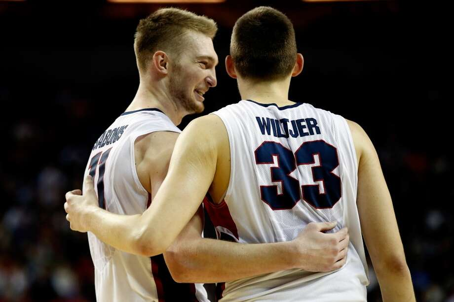 Domantas Sabonis and Kyle Wiltjer of the Gonzaga Bulldogs celebrate in the second half of the game against the Iowa Hawkeyes during the third round of the 2015 NCAA Men's Basketball Tournament at KeyArena on March 22, 2015 in Seattle, Washington. Photo: Ezra Shaw, Getty Images